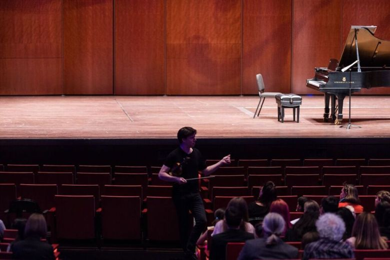 Joshua Bell opens a sound check and Q&A session in the H-E-B Performance Hall with students from YOSA, Trinity University, and Edgewood Fine Arts Academy orchestra. Courtesy photo.