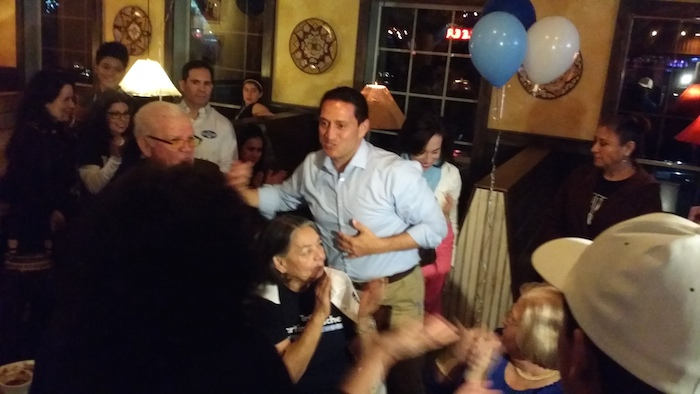 Trey Martinez Fischer hugs supporters gathered at Henry's Puffy Tacos. Photo by Iris Dimmick.