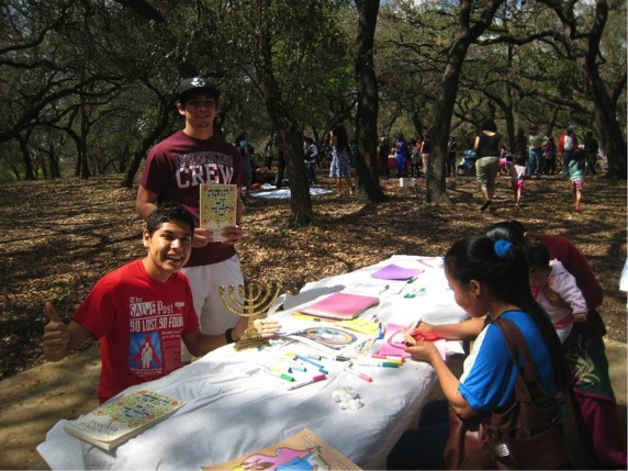 From left: UIW students Edwin Mendoza-Hipp from Guatemala and Christopher Olivares from San Antonio teach Asian refugee children about Passover. Photo by Sheena Maria Connell.