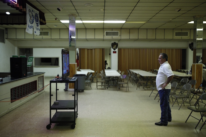 Candidate Tomás Uresti watches live results of the Democratic and Republican primaries. Photo by Scott Ball.