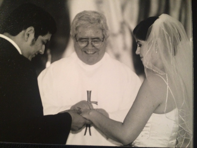 Fr. Virgilio Elizondo officiates the marriage of Victor and Cristina Sosa Noriega. Courtesy photo.