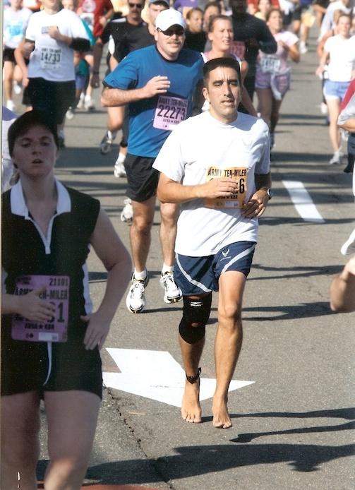 Victor Palma runs barefoot in the Army Ten Miler in Arlington, Va. circa 2006. Photo courtesy of Victor Palma.