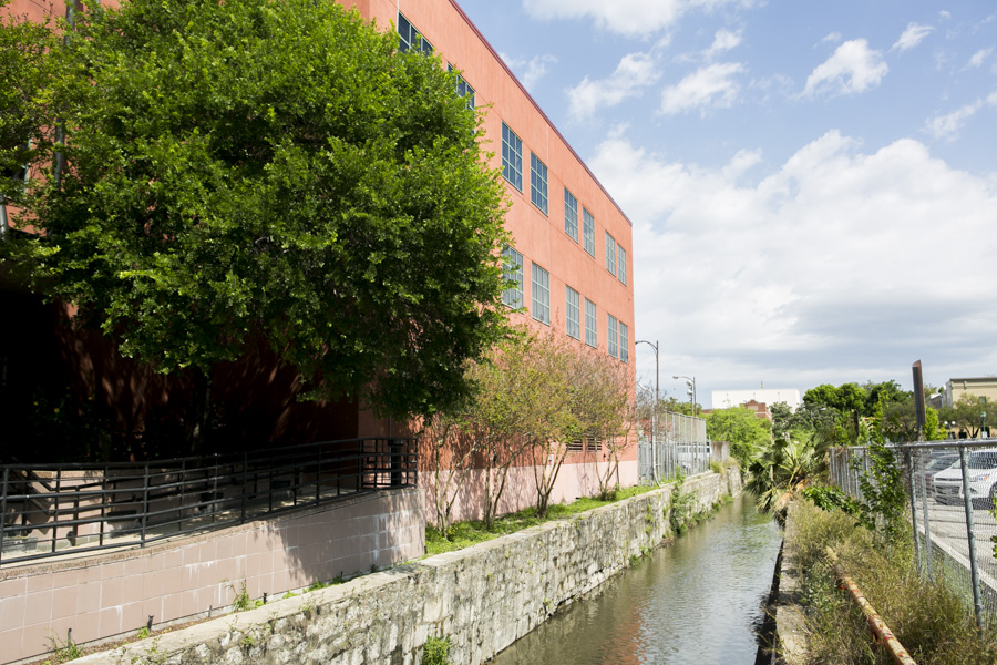 San Pedro Creek runs between County (left) and City (right) owned properties that the entities hope to sell to developers. Photo by Kathryn Boyd-Batstone