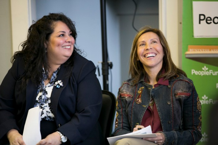 Tejas Premier Building Contractor CEO and Chair of the Small Business Committee Julissa Carielo and Councilwoman Shirley Gonzales (D5) share a laugh. Photo by Kathryn Boyd-Batstone