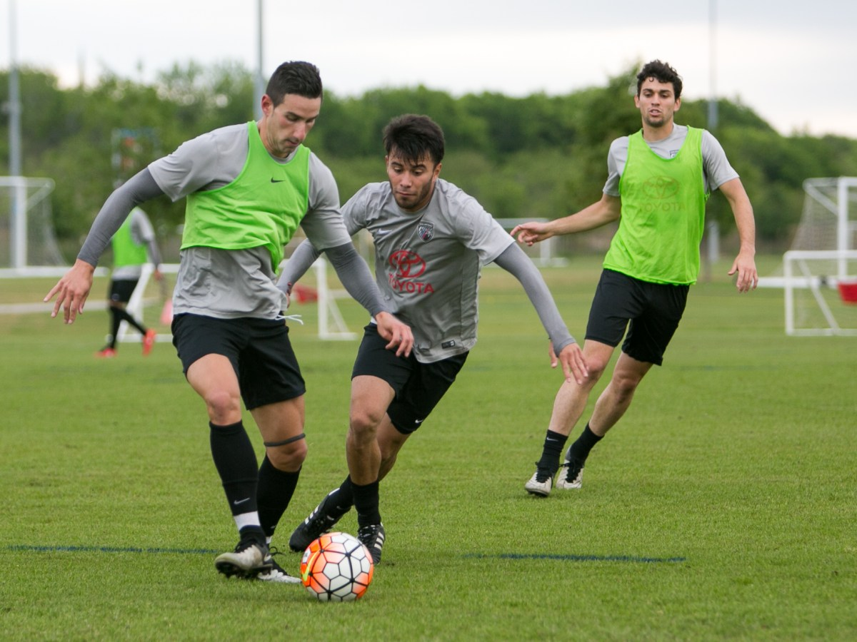 Midfielder Manolo Sanchez (left) and Midfielder Carlos Alvarez (right) compete for the ball at a practice. Photo by Kathryn Boyd-Batstone