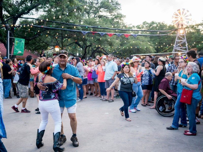A couple dances to country music in the La Villita courtyard. Photo by Kathryn Boyd-Batstone