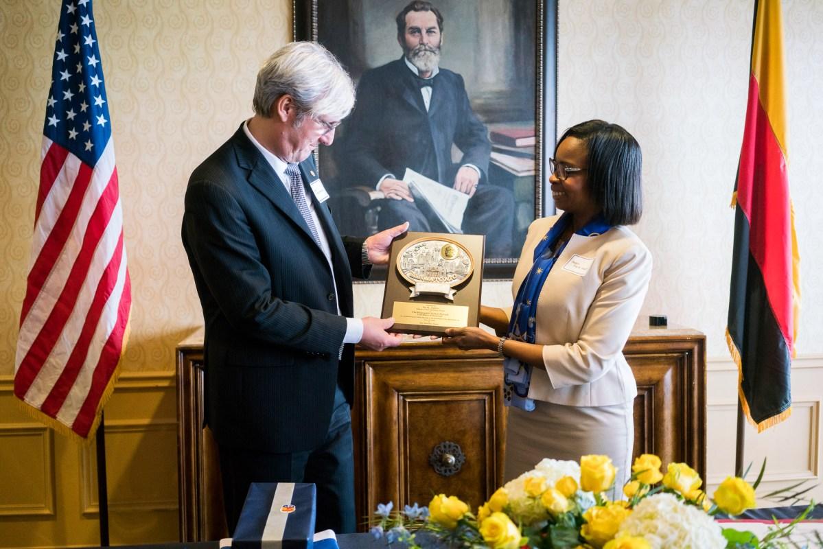Lord Mayor of Darmstadt Jochen Partsch accepts a gift from Mayor Ivy Taylor. Photo by Kathryn Boyd-Batstone