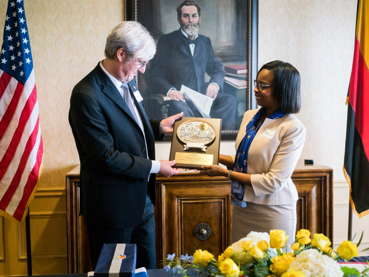 Lord Mayor of Darmstadt Jochen Partsch accepts a gift from Mayor Ivy Taylor. Photo by Kathryn Boyd-Batstone