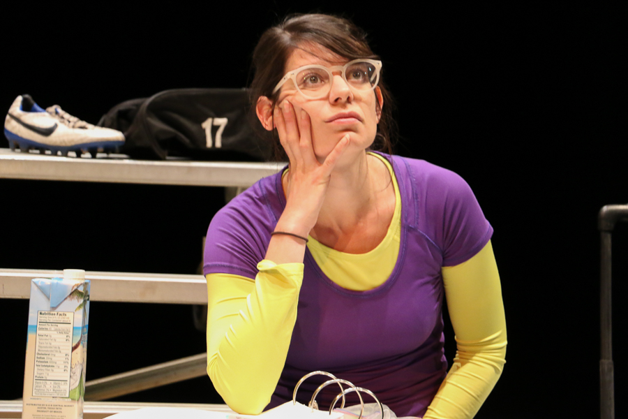 """Georgette Lockwood's character gazes with an exasperated expression during an eight hour tech rehearsal for AtticRep's production of """"Soccer Mom,"""" directed by Marisela Barrera at the Tobin Center for Performing Arts. Photo by Bria Woods."""