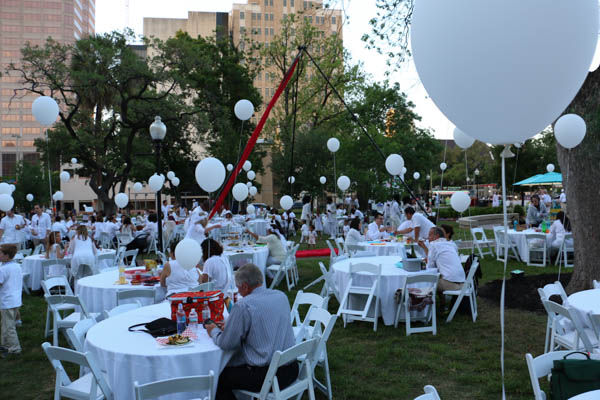 Travis Park and guests are donned in all white at the second annual Dinner en Blanc celebration. Photo by Bria Woods. Travis Park and guests are donned in all white at the second annual Dinner en Blanc celebration. Photo by Bria Woods.