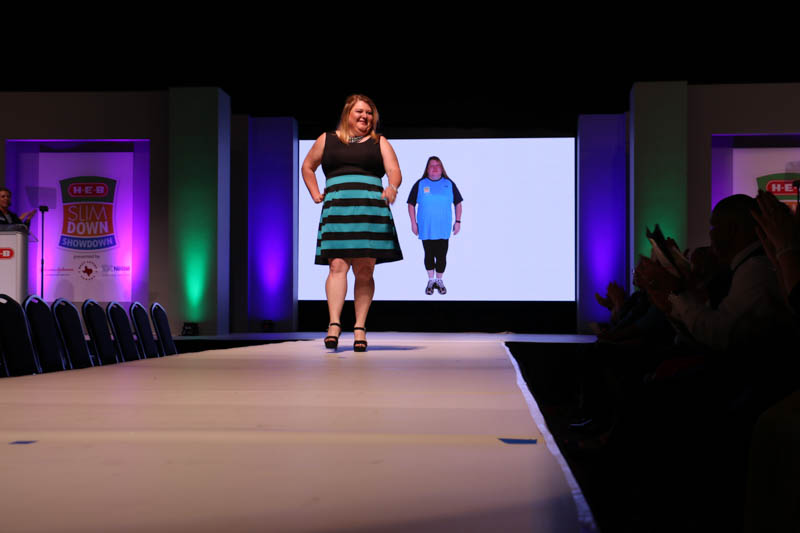 Michelle Giles flashes the audience a smile on the runway at the HEB Silmdown Showdown finale at the Henry B. Gonzalez Convention Center. Photo by Bria Woods.