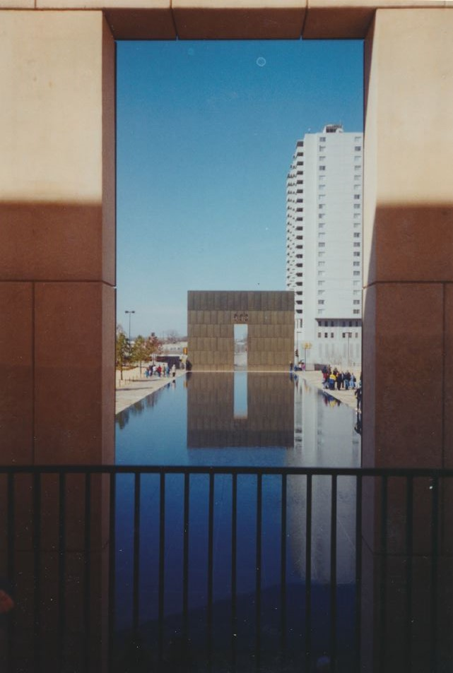 Twin portals frame the reflection pool, which once was the street in front of the Murrah Federal Building. Photo by Don Mathis.