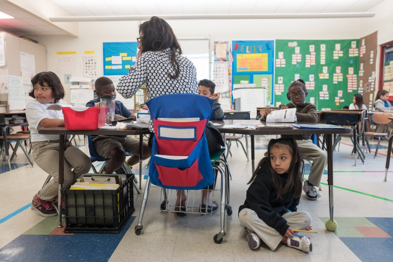 Elizabeth sits underneath the table in Ms. Smith's classroom. Photo by Scott Ball.