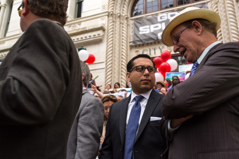 State Rep. Diego Bernal (D-123) speaks with Bexar County Judge Nelson Wolff (right) on the steps of City Hall. Photo by Scott Ball.