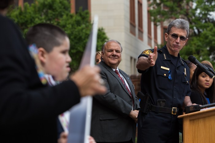 San Antonio Police Chief William McManus signals to Columba Wilson and her grandson Cristian, 11 who has suffered from alleged abuse by an elementary school teacher. Photo by Scott Ball.