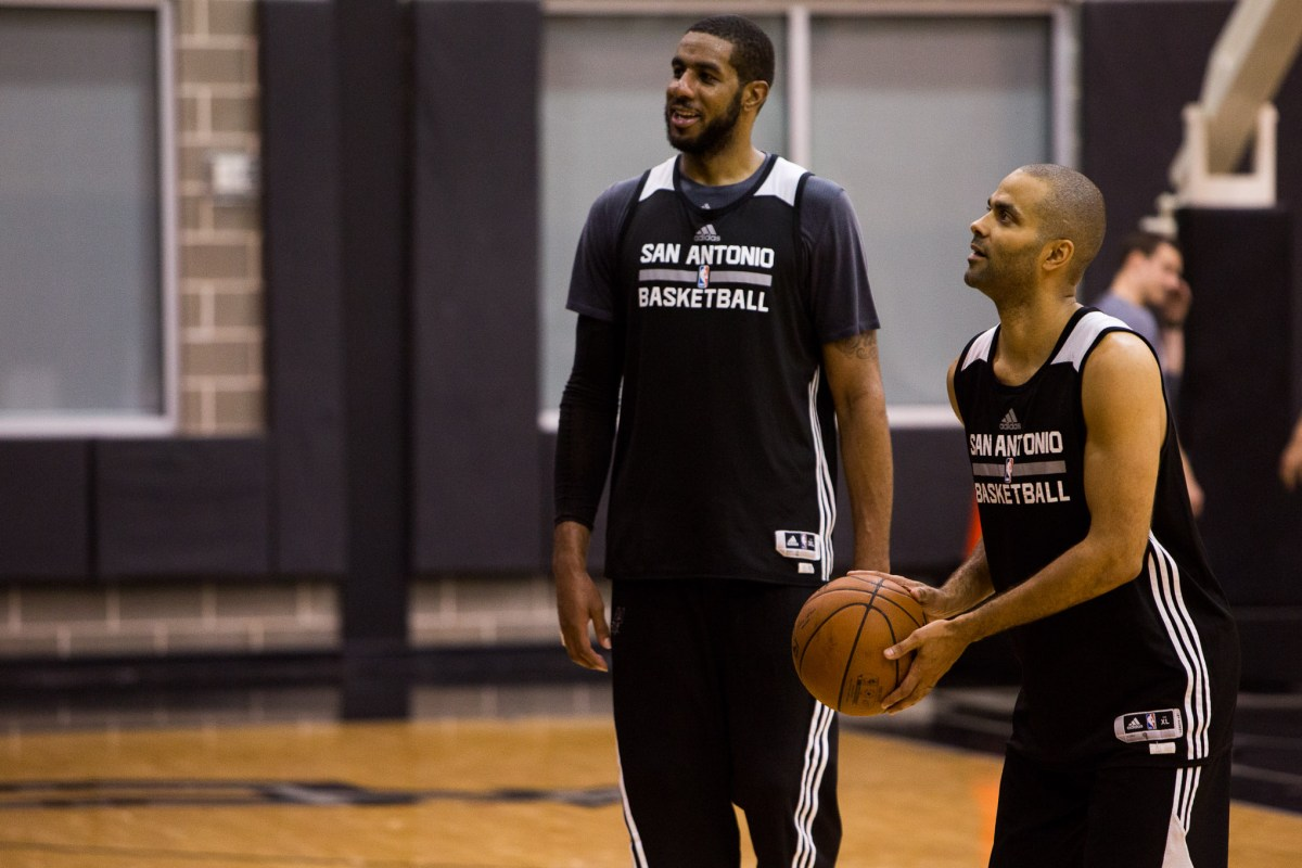 Spurs guard Tony Parker talks with Spurs Forward LaMarcus Aldridge during practice on April 27th, 2016. Photo by Scott Ball.