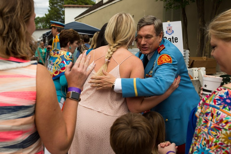 Texas Cavalier Richard Sparr hugs guests upon their arrival to the Arneson River Theater. Photo by Scott Ball.