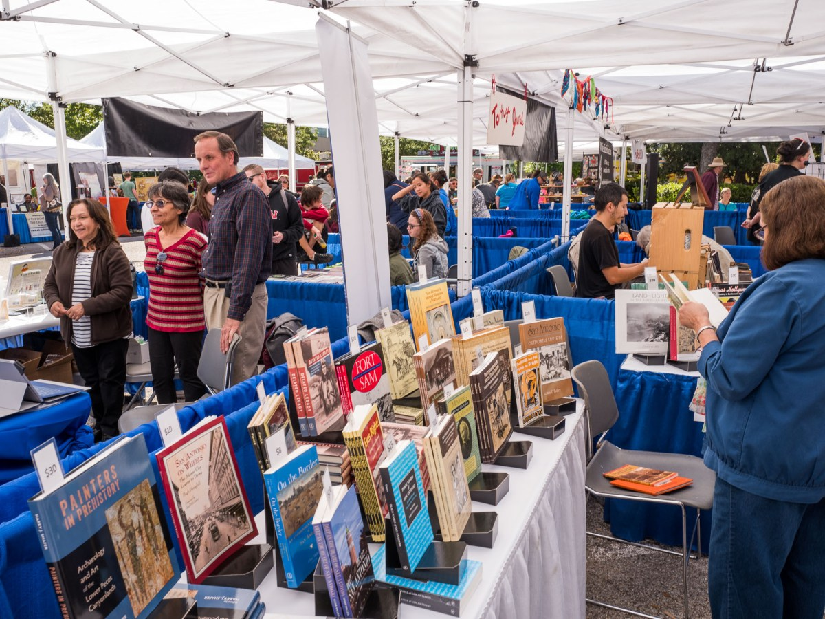 Families and book lovers survey the booths for novels and more. Photo by Scott Ball.