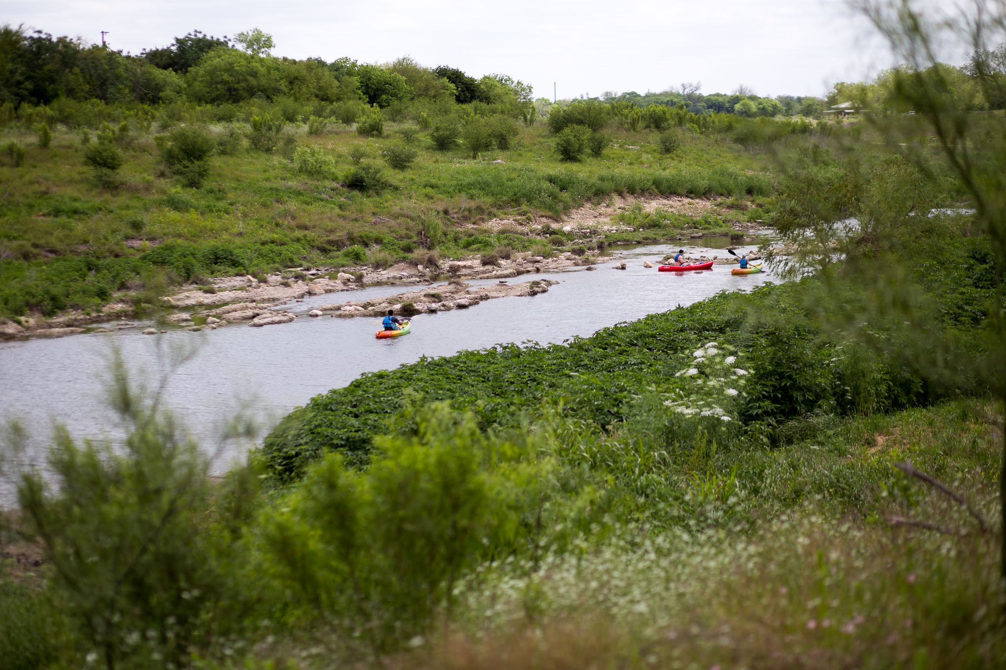 Kayakers paddle down the San Antonio River. Photo by Scott Ball.