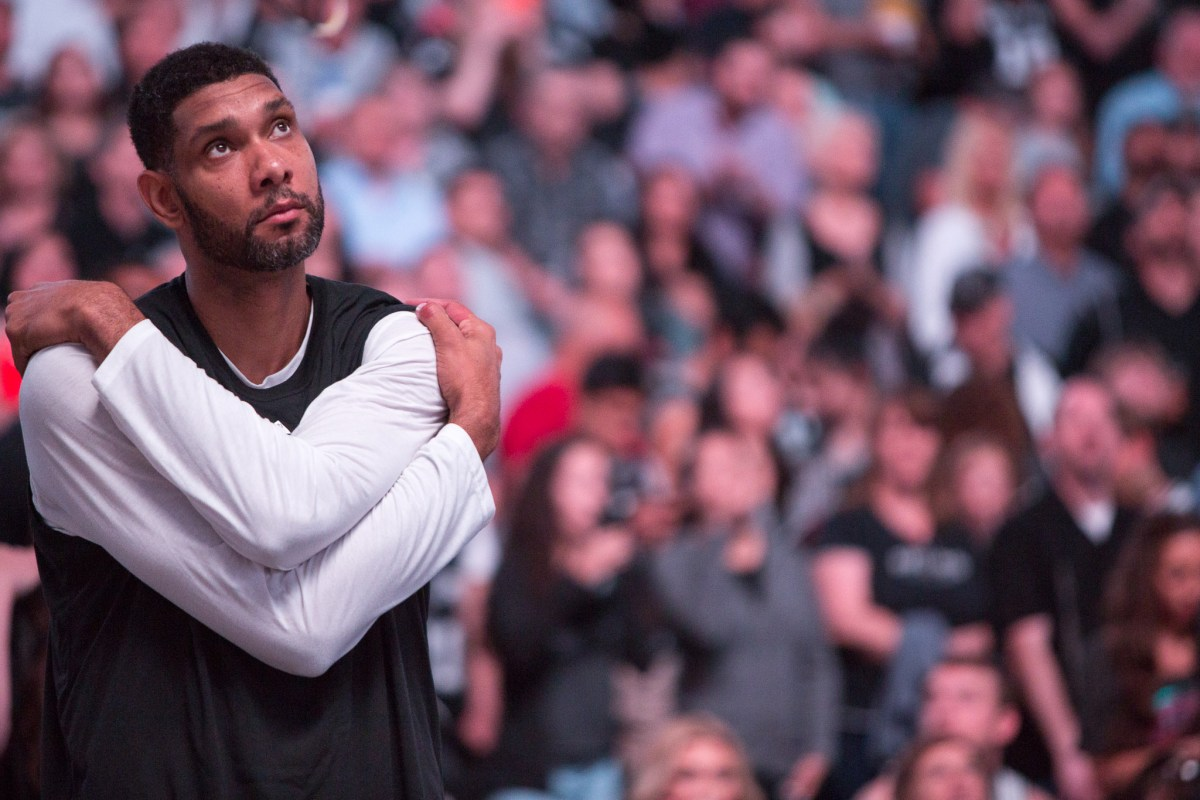 Spurs Power Forward Tim Duncan stretches moments before the game begins. Photo by Scott Ball.