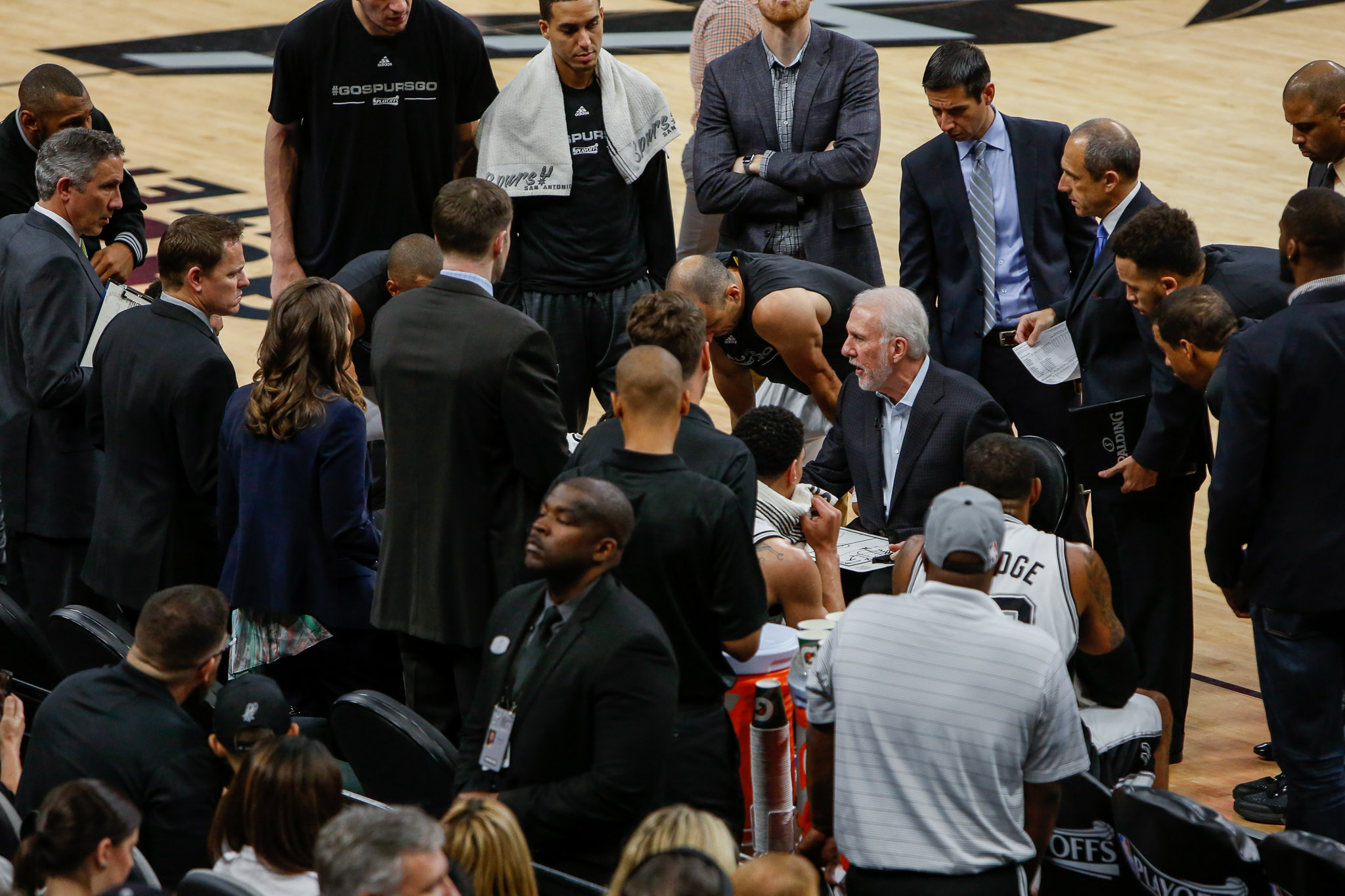Coach Gregg Popovich gathers his players during a twenty second timeout. Photo by Scott Ball.