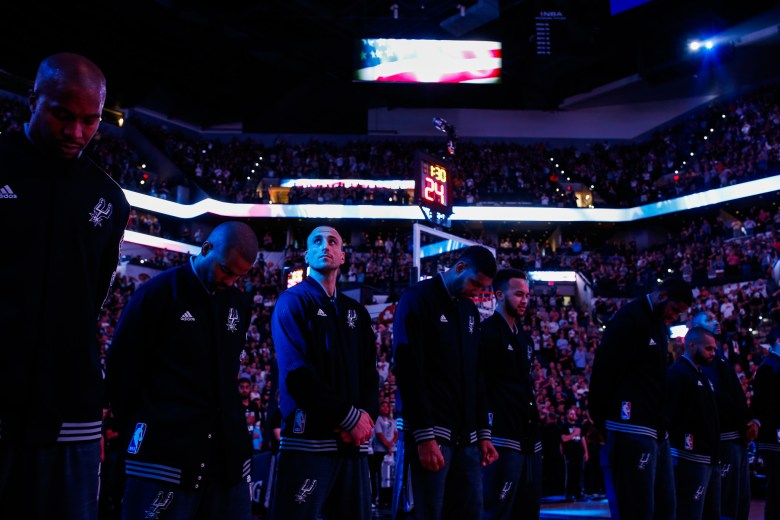 The San Antonio Spurs line up during the singing of the National Anthem. Photo by Scott Ball.