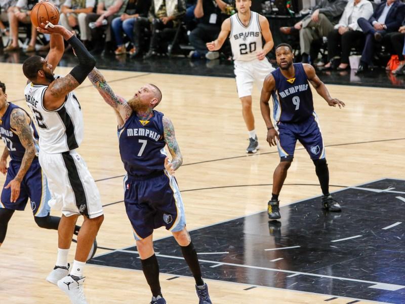 Spurs Forward LaMarcus Aldridge shoots a fade away jump shot over Memphis Center Chris Andersen. Photo by Scott Ball.