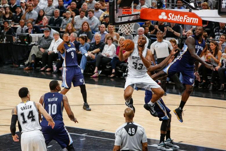 Boris Diaw of the San Antonio Spurs dodges Memphis defender Lance Stephenson on his way to the net. Photo by Scott Ball.
