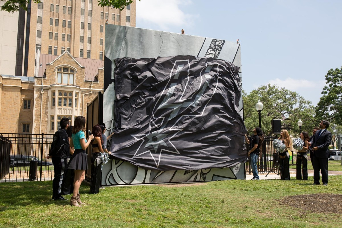 The unveiling of a mural painting the town silver and black in honor of the San Antonio Spurs by Shek Vega and Nic Soupé (1/4). Photo by Scott Ball.
