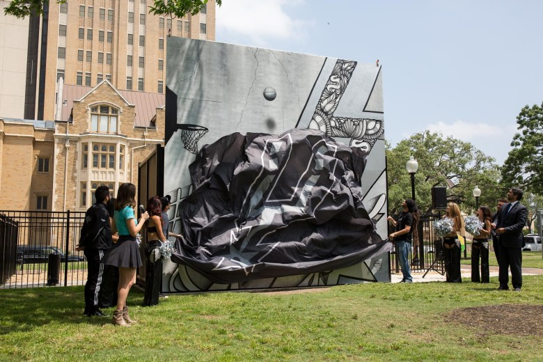 The unveiling of a mural painting the town silver and black in honor of the San Antonio Spurs by Shek Vega and Nic Soupé (2/4). Photo by Scott Ball.