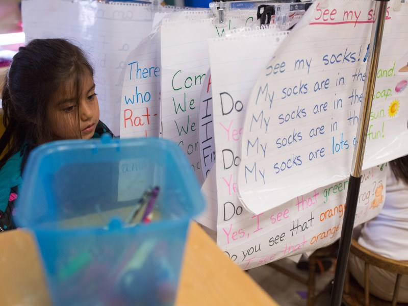 Students at Stewart Elementary work in a classroom covered with reading exercises.