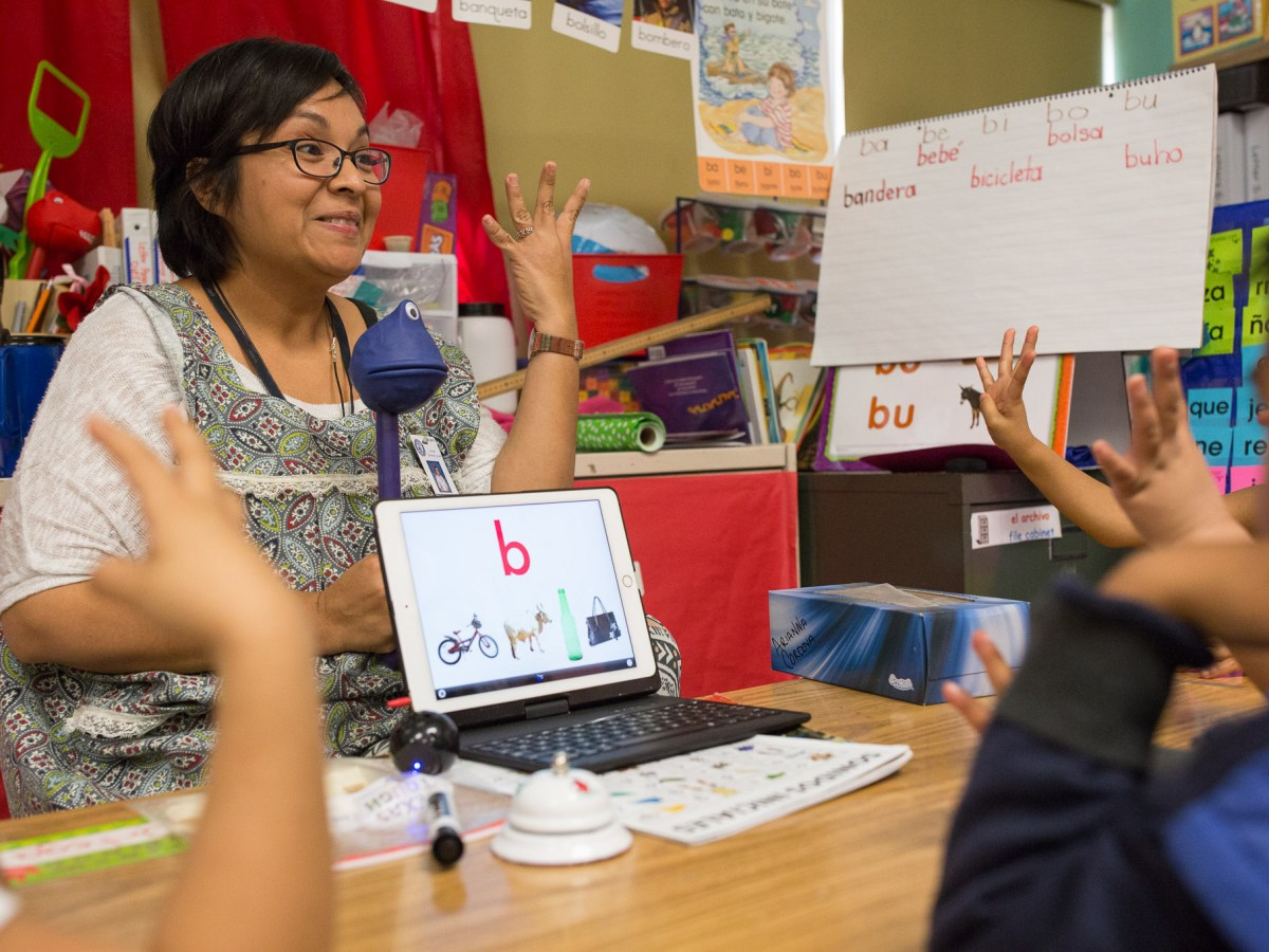 Pre-K Bilingual Teacher Ms. Godoy gives an alphabet lesson to her class. Photo by Scott Ball.