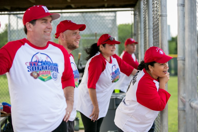 City Hall of Famers cheer on their teammates. Photo by Kathryn Boyd-Batstone