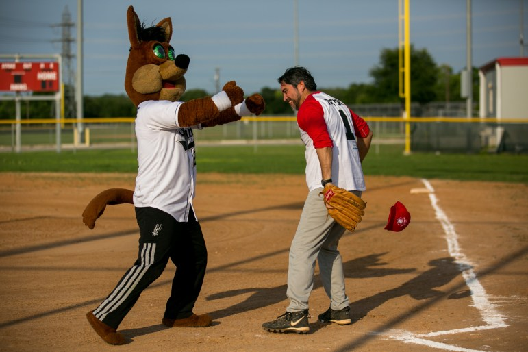 Councilman Roberto Treviño (D1) and the Spurs' Coyote battle it out before the start of the game. Photo by Kathryn Boyd-Batstone