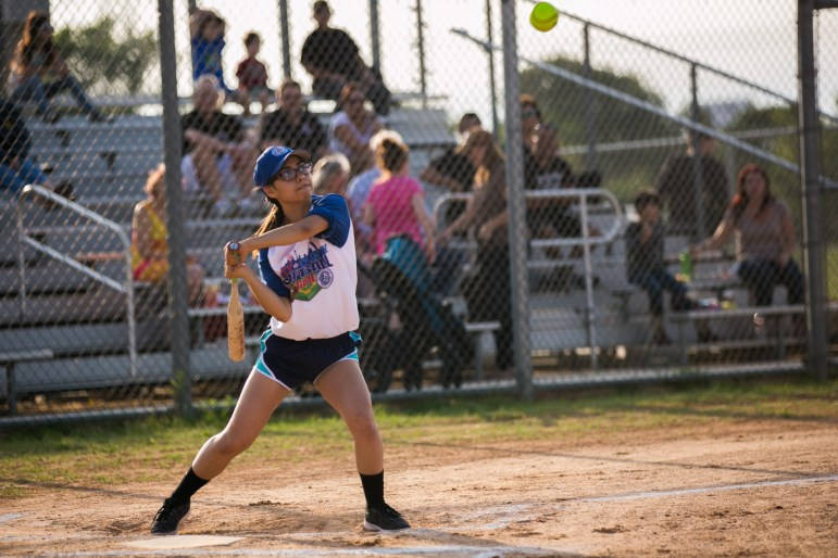 Selena Martinez of BiblioTech hits the ball in the first inning for the Big Bad Bexars. Photo by Kathryn Boyd-Batsotne