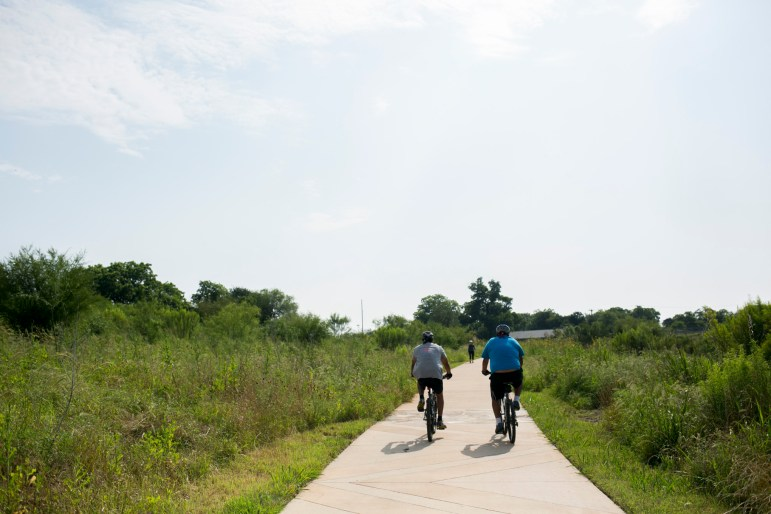Community members bike along the San Antonio Riverwalk. Photo by Kathryn Boyd-Batstone
