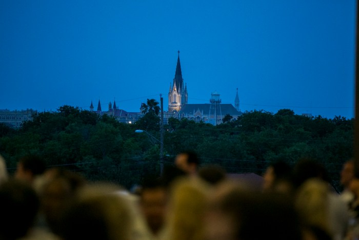Buildings of Our Lady of the Lake University stand tall in the distance during the Westside ceremony. Photo by Kathryn Boyd-Batstone.