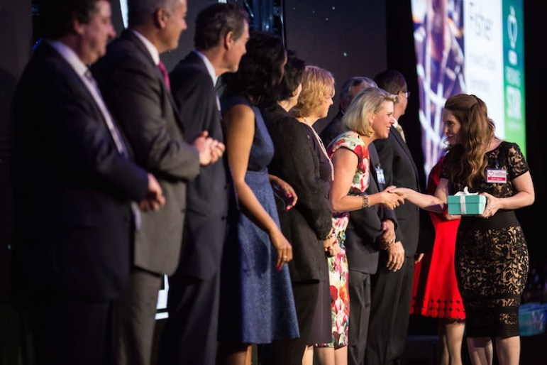 Judges greet finalists as they walk across the stage at the H-E B Excellence in Education Awards Celebration. Photo by Michael Cirlos