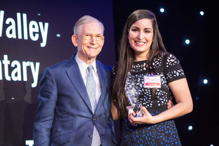 Teacher Hilda Nanez poses with H-E-B Chairman and CEO Charles Butt. Photo by Michael Cirlos.