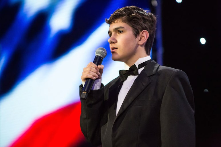 Tony Rodriguez sings the national anthem at the HEB Excellence in Education Awards celebration. Photo by Michael Cirlos
