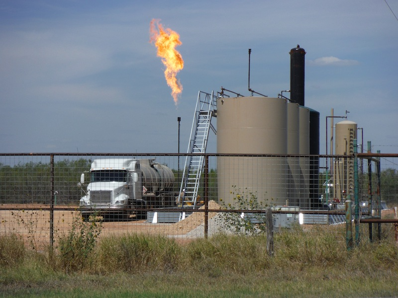 A facility with a large methane flare in the Eagle Ford Shale region. Photo by Mario Bravo.