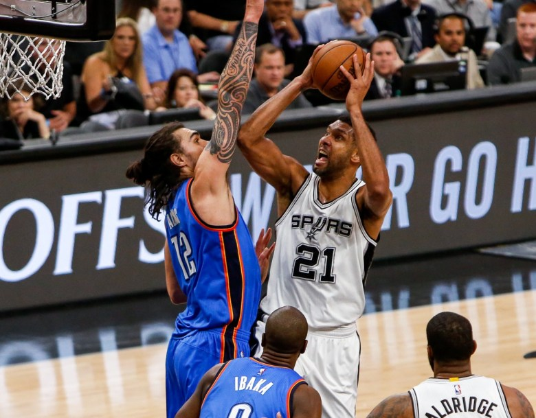Spurs center #21 Tim Duncan shoots over Thunder Center #12 Steven Adams. Photo by Scott Ball.