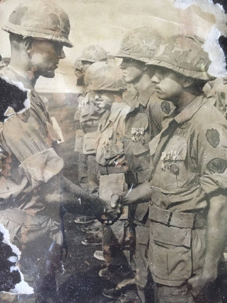 Colonel McGowan (left) congratulates Sgt. Fernando Herrera (right) for his Silver Cross award.  Commanding officers would be flown to the base camps for award ceremonies. Base camp, 25th Division, U. S. Army, Cu Chi, Vietnam, circa 1968.  Photo courtesy of Sgt. Fernando Herrera.