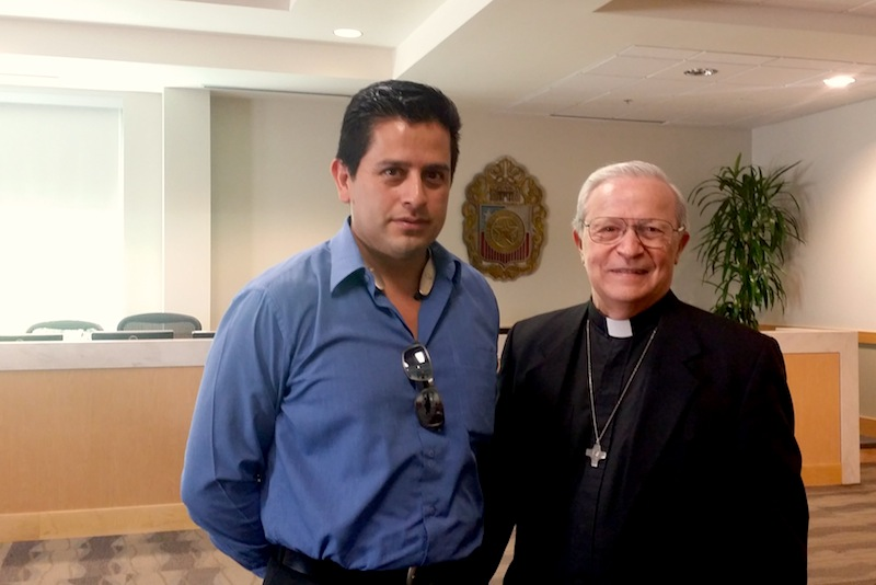 Pastor Assistant Salvador Olvera (left) and Father Mario Marzocchi of St. Joseph Catholic Church after the Historic and Design Review Commission approved plans for a new parish hall on May 4, 2016. Photo by Iris Dimmick.