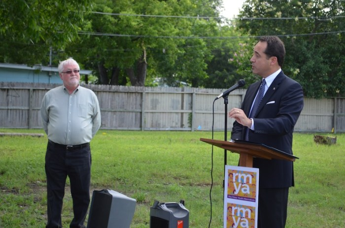 State Sen. José Menéndez (D-26) says San Antonio has more work to do for ending child abuse, as RMYA CEO Bill Wilkinson looks on. Photo by Camille Garcia.