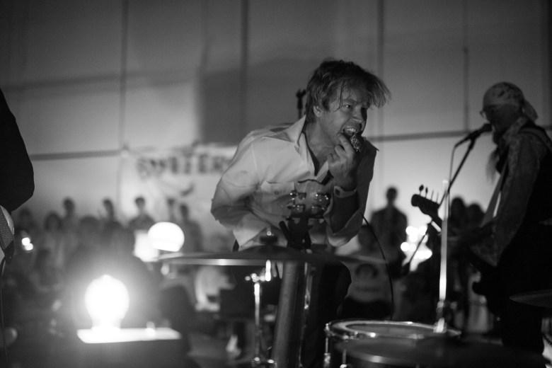 Erik Sanden jumps with ferocity as he sings. Photo by Scott Ball.
