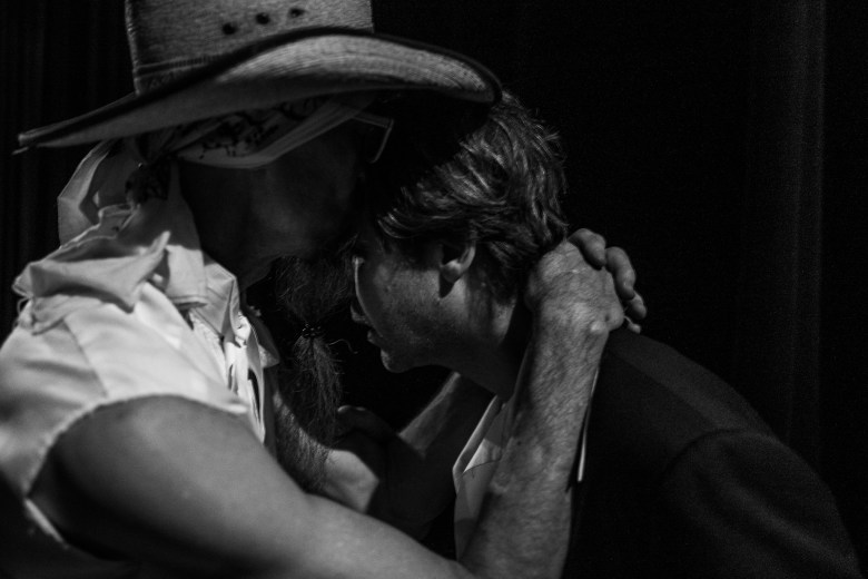 Buttercup bassist, Odie, embraces Erik Sanden before the performance. Photo by Scott Ball.