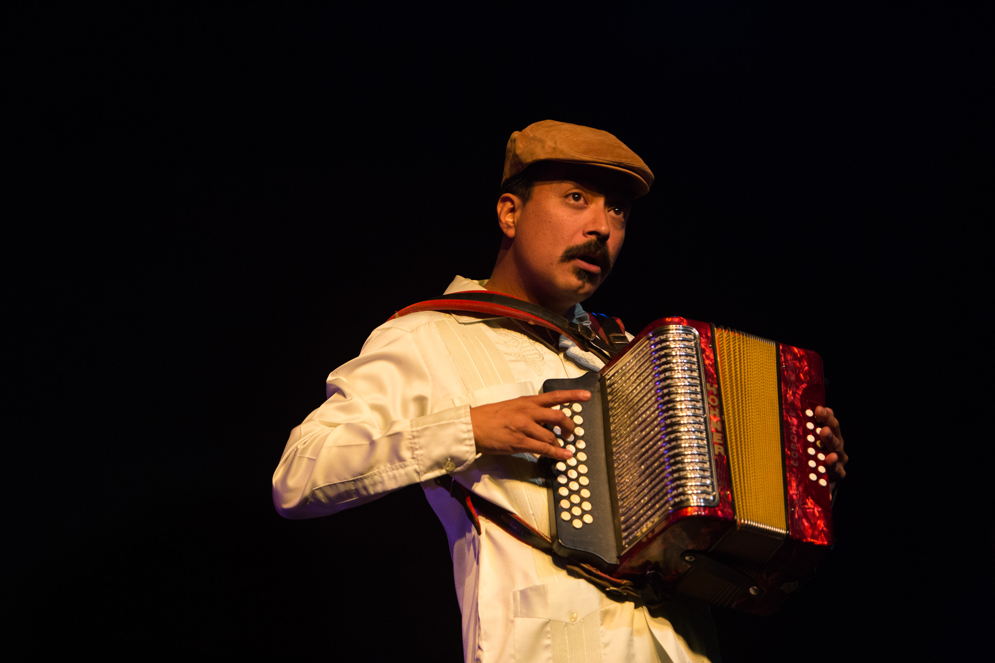 Nicolas Valdez opens up the sound of the accordion for the audience members. Photo by Scott Ball.