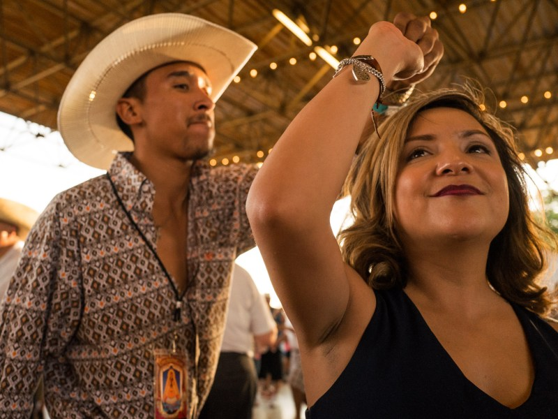 A couple heads to the dance floor as Los Tremendos V takes the stage. Photo by Scott Ball.