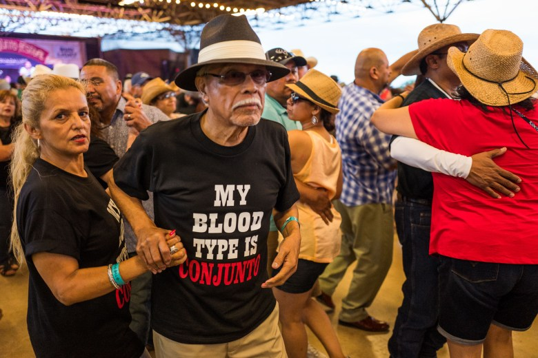 Couples dance on the floor as conjunto music plays loudly. Photo by Scott Ball.